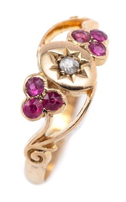 Sale 9194 - Lot 387 - A VICTORIAN STYLE 18CT GOLD RUBY AND STONE SET RING; oval plaque star set with an old European cut diamond flanked by 2 shamrocks se...