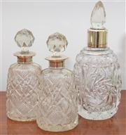 Sale 8595A - Lot 96 - A pair of crystal and silver topped perfume bottles one repaired, together with another as found, tallest H 17cm