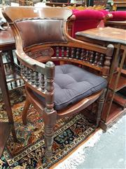 Sale 8868 - Lot 1074 - Late Victorian Oak Office Armchair, with brown vinyl padded back, turned galley back & timber seat with loose cushion, on turned legs