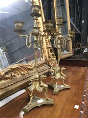 Sale 8882 - Lot 1090 - Pair of 19th Century French Gilt Brass Candelabra, in the eclectic style, with three branches and four sconces, the base with gryphons