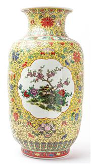 Sale 9083N - Lot 47 - A large famille Verte shouldered vase depicting birds and butterflies in panels on a yellow ground. Height 60cm