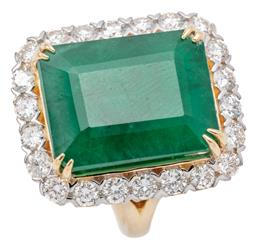 Sale 9132 - Lot 434 - AN IMPRESSIVE 18CT GOLD EMERALD AND DIAMOND COCKTAIL RING; featuring an emerald cut emerald of 13.50ct to a surround of 22 round bri...