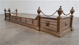 Sale 9215 - Lot 1044 - Victorian Brass Fire Fender, in the neoclassical style, the pierced rails with rosettes, surmounted by corner post urns joined by ch...
