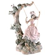 Sale 8000 - Lot 166 - A Lladro figure of a young woman on a swing.
