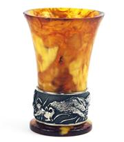 Sale 8373 - Lot 334 - AN AMBER CUP; with silver rim featuring boar and hound chase, height 85mm, slight chips and repair to rim and base, Russian marks