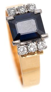 Sale 9095 - Lot 348 - A VINTAGE 18CT GOLD SAPPHIRE AND DIAMOND RING; curved collet set with an Australian type emerald cut dark blue sapphire of approx. 2...