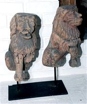 Sale 8048A - Lot 30 - A Pair of distressed carved lion figures on a metal stand. 54 (h)