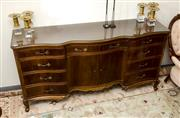 Sale 8205 - Lot 8 - A Continental style mahogany veneered two door serpentine front sideboard, with nine drawers on short cabriole legs, with glass top,...