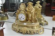 Sale 8261 - Lot 81 - Gilt Metal Figural Mantle Clock
