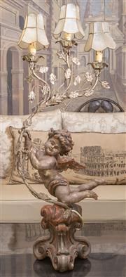 Sale 8568A - Lot 53 - A Rococo style gesso and metal table lamp of a flying cherub resting on a socle and supporting a three branch foliate light, H 94cm,...