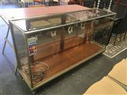 Sale 8740 - Lot 1511 - Vintage Brass Bound Glass Display Cabinet with Claw Feet to Front