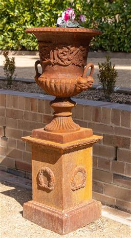 Sale 9248H - Lot 253 - A pair of rust patinated cast iron urns on pedestals. height110cm R