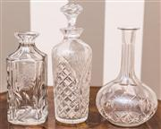 Sale 8222 - Lot 75 - Three glass decanters, two stoppers missing, one chipped, tallest 29cm