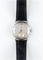 Sale 8770 - Lot 79 - A Vintage Omega Wristwatch; in stainless steel with matte dial, subsidiary seconds, 17 jewel manual movement, C - 1944, (dislodged m...