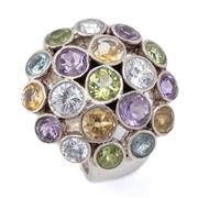 Sale 8999 - Lot 322 - A SILVER GEMSET RING; 24.5mm wide dome top collet set with round cut amethyst, peridot, citrine, topaz and zirconia, (some chips), s...