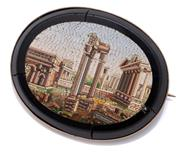 Sale 9020 - Lot 384 - AN ANTIQUE ITALIAN MICRO MOSAIC BROOCH; 49 x 39mm oval onyx brooch (with cracks) applied with mosaic depicting the Roman Forum in ro...