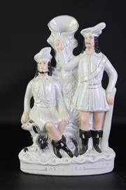 Sale 8923B - Lot 22 - A large Staffordshire statue of Robin Hood and one of his merry men. Height 39cm