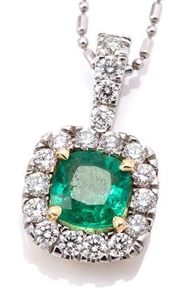 Sale 9132 - Lot 424 - A WHITE GOLD EMERALD AND DIAMOND PENDANT NECKLACE; cushion form 18ct cluster pendant centring an approx. 0.60ct cushion cut emerald...