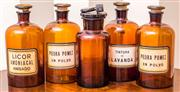 Sale 8222 - Lot 26 - A collection of five brown glass apothecary bottles, tallest 24cm