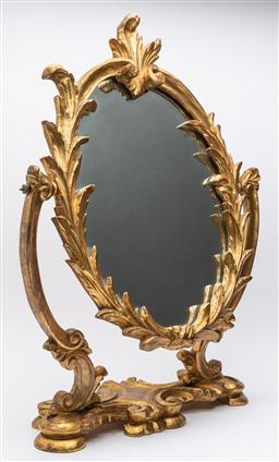 Sale 9099 - Lot 78 - A giltwood toilet mirror with oval laurel leaf framed mirror. Height 59cm x Width 42cm