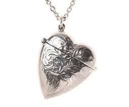 Sale 9124 - Lot 455 - A VICTORIAN STYLE STERLING SILVER HEART SHAPE VESTA LOCKET ON CHAIN; 3.5 x 4cm scroll engraved case on a cable link chain, length 60...