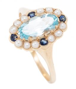 Sale 9168J - Lot 365 - AN EDWARDIAN STYLE TOPAZ SAPPHIRE AND PEARL RING; centre claw set with an oval cut blue topaz to surround of 12 seed pearls and 4 ro...
