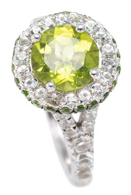 Sale 9194 - Lot 308 - A PERIDOT AND TOPAZ CLUSTER RING; set in silver with a central round cut peridot to surround, gallery and split shoulders all set wi...