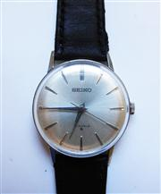 Sale 8272A - Lot 38 - A vintage Seiko men's wristwatch. Manual wind. Stainless steel case with leather strap, 34 mm without crown.