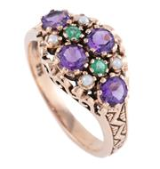 Sale 8928 - Lot 335 - AN EDWARDIAN STYLE SUFFRAGETTE GEMSTONE RING; set with round cut amethysts and emeralds and seed pearls between engraved shoulders i...