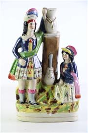 Sale 8940T - Lot 663 - Staffordshire figural group of a man and a lady (H29cm)