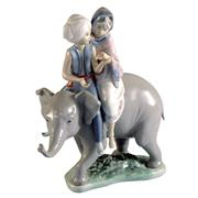 Sale 8000 - Lot 207 - A Lladro group of two children riding an elephant, printed and impressed marks to base.