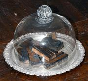 Sale 8048A - Lot 34 - A Silver Plate Tray with type set timber letters and glass dome.