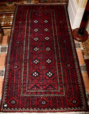 Sale 8080A - Lot 27 - A west Persian wool carpet in red and black tones. 197 x 105cm