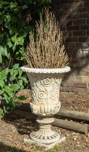 Sale 8745A - Lot 6 - A stoneware pot containing a conical form arrangement of dried branches