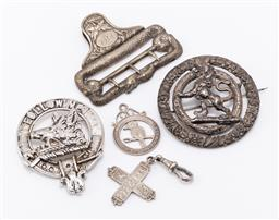 Sale 9180E - Lot 142 - A small collection of pins and charms including silver