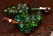 Sale 8048A - Lot 35 - A bunch of grapes together with a green glass decanter in form of grapes