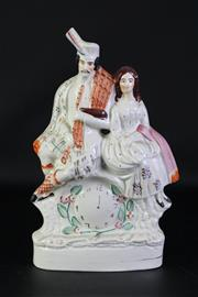 Sale 8923B - Lot 68 - A Staffordshire flat back figural group of Piper and Lass on a clock tower. Height