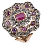 Sale 9046 - Lot 389 - A 14CT GOLD AND SILVER GEMSET COCKTAIL RING; 26 x 23mm contoured alternating gold and silver setting centring an oval cut ruby surro...