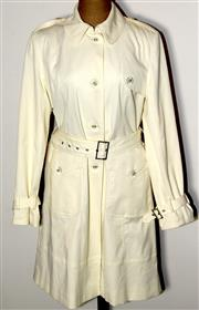 Sale 8134B - Lot 347 - A DONNA KAREN NEW YORK CREAM TRENCH COAT; with belt (S).