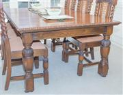 Sale 8402H - Lot 40 - An oak extension dining table in the Jacobean style with carved cup and cover legs on casters.