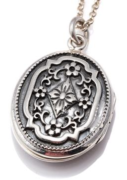 Sale 9124 - Lot 453 - A VICTORIAN STYLE SILVER LOCKET ON CHAIN; oval locket with floral decoration on a belcher chain with bolt ring clasp, length 56cm, l...