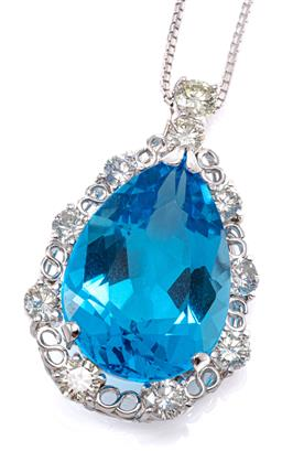 Sale 9132 - Lot 452 - AN 18CT WHITE GOLD TOPAZ AND DIAMOND PENDANT NECKLACE; drop shape pendant centring a pear cut blue topaz of approx. 26.65ct to infin...