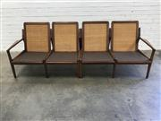 Sale 9092 - Lot 1087 - Modular blackwood 4 seater vintage lounge by DON REX with woven rattan back  (h:74 x w:235 x d:74cm)