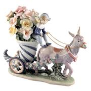 Sale 8000 - Lot 208 - A Lladro figural group of a donkey pulling a boy on a cornucopia of flowers, titled Carrito de fantasia,