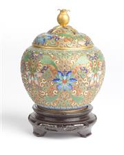 Sale 8536 - Lot 11 - A Chinese Cloisonne lidded pot with opium form finial raised on timber stand, total height 18cm