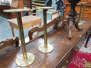 Sale 8416 - Lot 1006 - Set of Four Brass Candle or Vase Stands, with round platforms & bases (h 38)