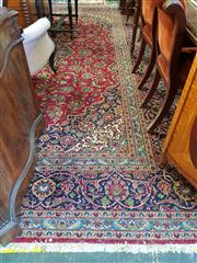 Sale 8792 - Lot 1086 - Kashan Wool Carpet, with blue medallion, pendants & arabesques on a red field 404 x 304 cm