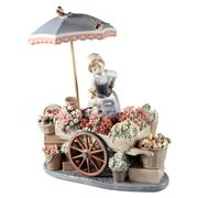 Sale 8000 - Lot 162 - A Lladro figural group of a flower seller with her wares, printed and impressed marks to base. Reference no. 1454.