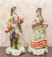 Sale 8375A - Lot 2 - A pair of German porcelain figures of a courting couple in 18th century costume, marked to foliate scroll base. Height: 44cm.