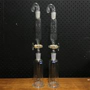 Sale 8758 - Lot 198B - Pair of Quickfit Separating Funnels with stoppers fitted to receiving bottles